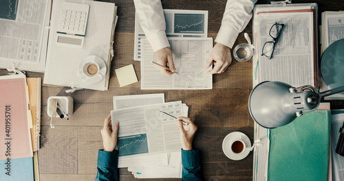Fototapeta Business people working together and checking financial charts obraz