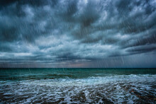 A Background With Dark Clouds, Heavy Rain And Waves On A Stormy Sea