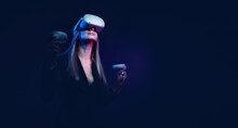 Young Woman With Blond Hair In A Vr Helmet Looks Around With Surprise And Delight