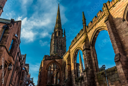 Fototapeta The spires and arches of the ruins of St Michaels Cathedral in Coventry, UK obraz