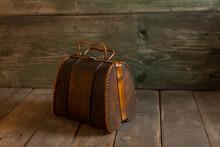Vintage Handbag On A Wooden Background.