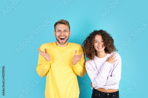Two mixed race people standing on blue background Wallpaper Mural