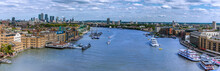A Panorama View Of London, UK Eastward Along The River Thames Towards Canary Wharf From The Tower Bridge