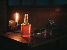 Mafioso Table In The Style Of The 40s - 50s. Whiskey, Lamp, Revolver, Cartridges