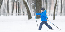 Small Boy Cross-country Skiing In The Park