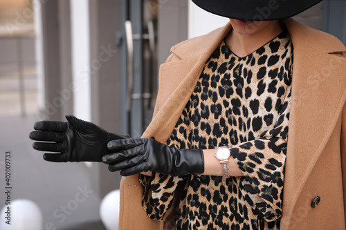 Obraz Young woman in stylish black leather gloves outdoors, closeup - fototapety do salonu