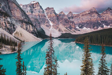 The Beautiful Deep Blue Waters And Reflections Of Moraine Lake At Sunrise. Moraine Lake Is Located In Banff National Park In Alberta, Canada, Situated In The Valley Of Ten Peaks.