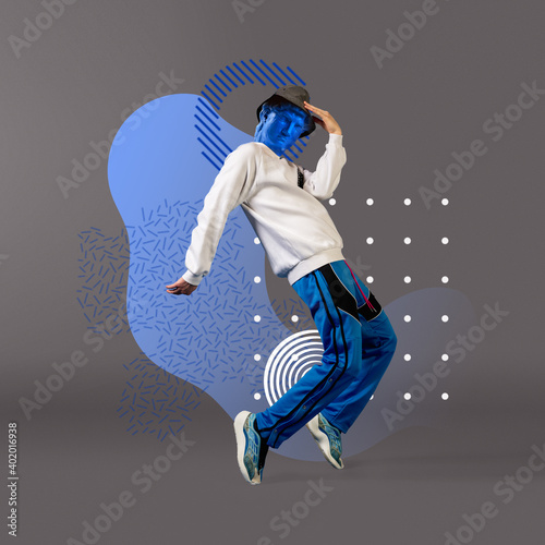 Obraz Celebrity, weightless. Stylish man headed by bright statue on grey background. Negative space to insert your text. Modern design. Contemporary colorful and conceptual bright art collage. - fototapety do salonu