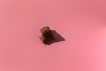 Pieces Of Chocolate On A Pink Background With Hard Light