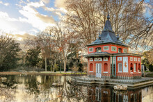 Fisherman's Small House In Retiro Park Of Madrid, With Bare Trees And A Lake Around - Winter Wallpaper
