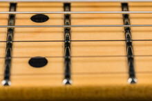 A Selective Focus Oelectric Guitar Strings And Fretboard