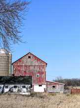 Weathered Red Barn In The Country