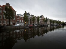 Typical Amsterdam Style Architecture Exterior Facade Reflection Of Houses Buildings In Amstel Canal Holland Netherlands