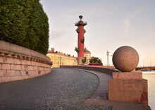 Morning On The Spit Of Vasilievsky Island. View Of The Rostral Column, Granite Parapet With A Stone Ball On The Embankment