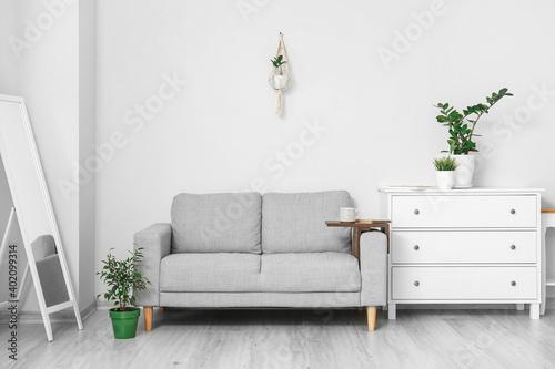 Obraz Armrest table on sofa in interior of room - fototapety do salonu