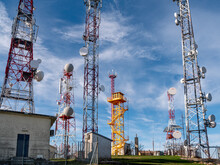A Cloudy Sky Behind Telecommunication Wireless Towers With Antennas