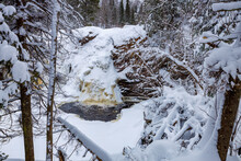 Frozen Little Manitou Falls With Fresh Snow During Winter At Pattison State Park In Superior Wisconsin