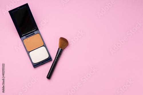 Fototapeta Make up palette with brush on pink background