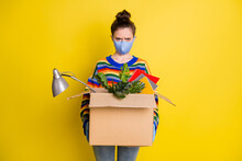 Photo Of Girl Hold Box Got Fired Wear Blue Mask Gloves From Corona Rainbow Sweater Pants Isolated On Bright Yellow Color Background