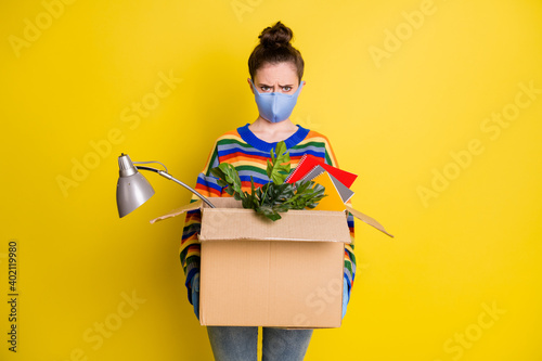 Obraz Photo of girl hold box got fired wear blue mask gloves from corona rainbow sweater pants isolated on bright yellow color background - fototapety do salonu