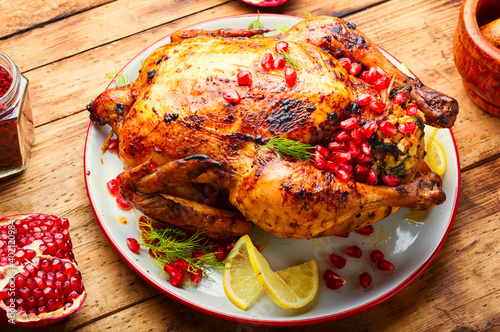 Chicken roasted with pomegranate © nikolaydonetsk