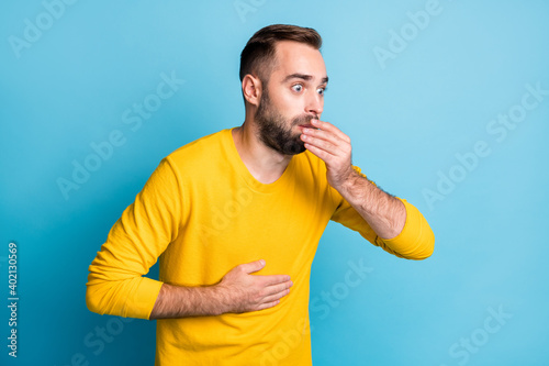 Fototapeta Photo of young handsome shocked surprised amazed man vomit nauseous unhealthy is