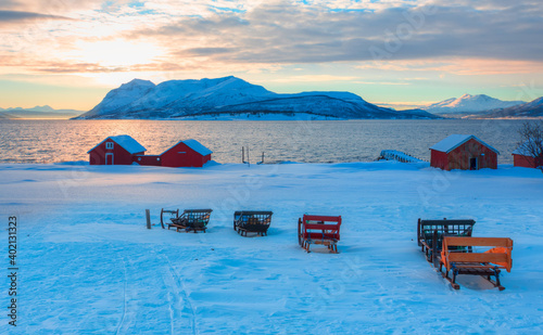 Fototapeta Panoramic view at fjord with coast of the Norwegian sea in the background snowy