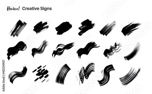 Fotografiet Set di sbaffi di vernice nera fatti con pennello secco