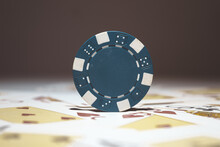 A Selective Focus Shot Of Blue Poker Chip - Casino And Gambling Concept