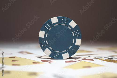 A selective focus shot of blue poker chip - casino and gambling concept Wallpaper Mural