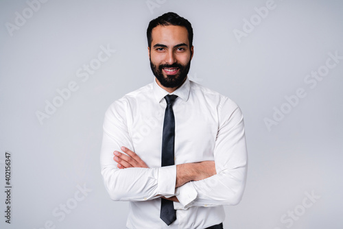 Photo Successful 25s Middle East businessman in formal shirt isolated over grey backgr