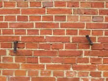 Just Another Red Brick Wall. Two Metal Holders