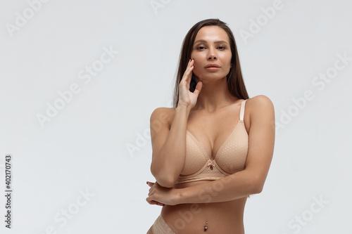 Obraz na plátně Slim woman in lingerie in studio
