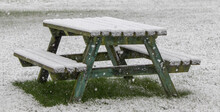 Picnic Table Under A Fall Of Snow In A Snowstorm