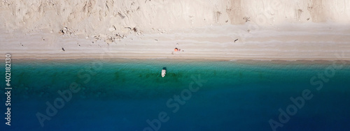 Obraz Aerial drone ultra wide panoramic photo of famous azure sandy beach of Egremni, Lefkada island, Ionian, Greece - fototapety do salonu