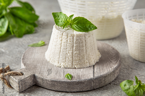 Homemade whey ricotta cheese or cottage cheese with basil ready to eat Fototapeta