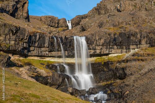 Waterfall Bergarfoss in Hornafjordur in south Icelandic countryside