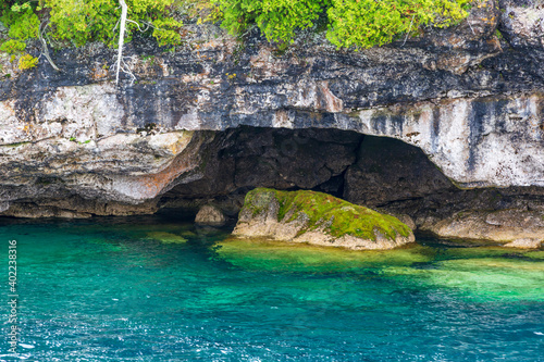 Small cave near the coast of the Flowerpot Island in crystal clear blue waters of Georgian Bay