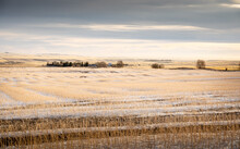 Winter Snow Over A Harvested Wheat Field And Farm On The CanadianPrairies In Rocky View County Alberta