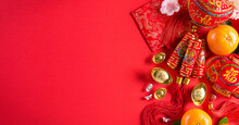 Chinese New Year Festival Decorations Pow Or Red Packet, Orange And Gold Ingots On A Red Background. Chinese Characters FU In The Article Refer To Fortune Good Luck, Wealth, Money Flow.