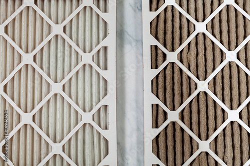 Fototapeta Side by side close up view of a new unused and an old heavily clogged dirty air filters. Image emphasizes the role of framed filters in improving air quality and preventing respiratory problems. obraz