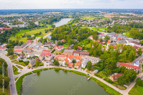 Fototapeta Talsi, Latvia, Baltics. Aerial view photo from flying drone panoramic to Talsi old town and new town on a sunny summer day. (Series) obraz na płótnie