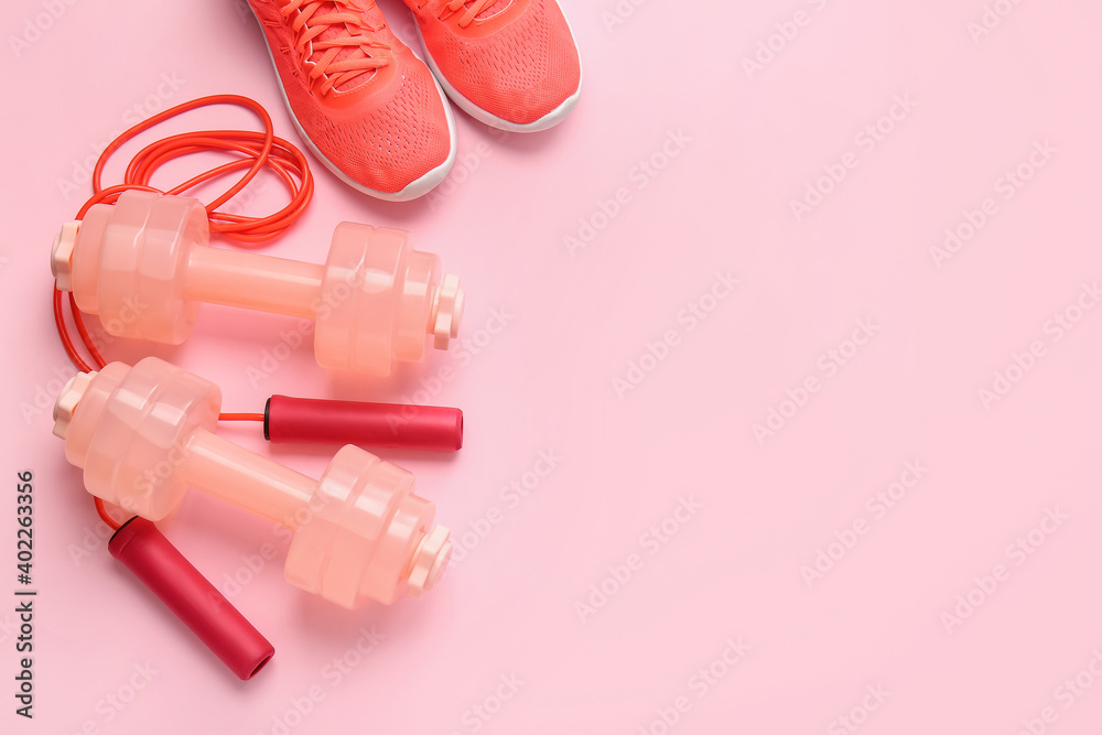 Obraz Dumbbells, sport shoes and skipping rope on color background fototapeta, plakat