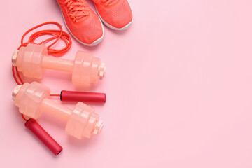 Fototapeta Koszykówka Dumbbells, sport shoes and skipping rope on color background