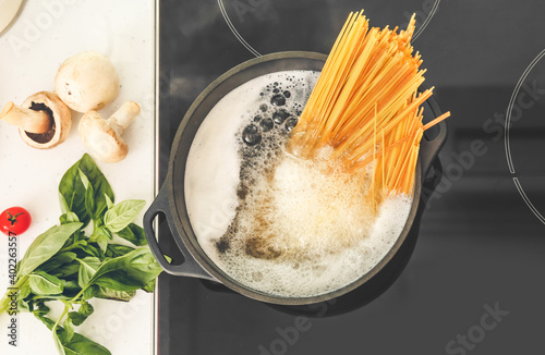 Pasta boiling in cooking pot on electric stove