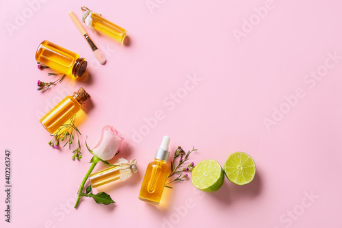 Obraz Bottles with floral essential oil on color background - fototapety do salonu