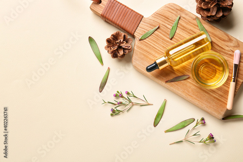 Herbal essential oil on light background