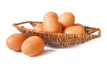 Easter Egg In A Basket And Two Egg Out A Basket Isolated On A White Background