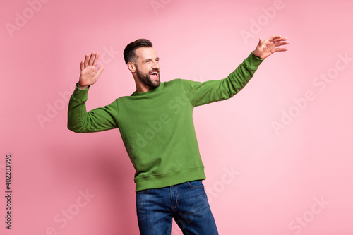 Obraz Portrait of attractive cheerful mature carefree guy having fun dancing enjoying life isolated over pink pastel color background - fototapety do salonu