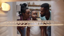 Afro-american Hungry Family Looking Into Empty Fridge At Home